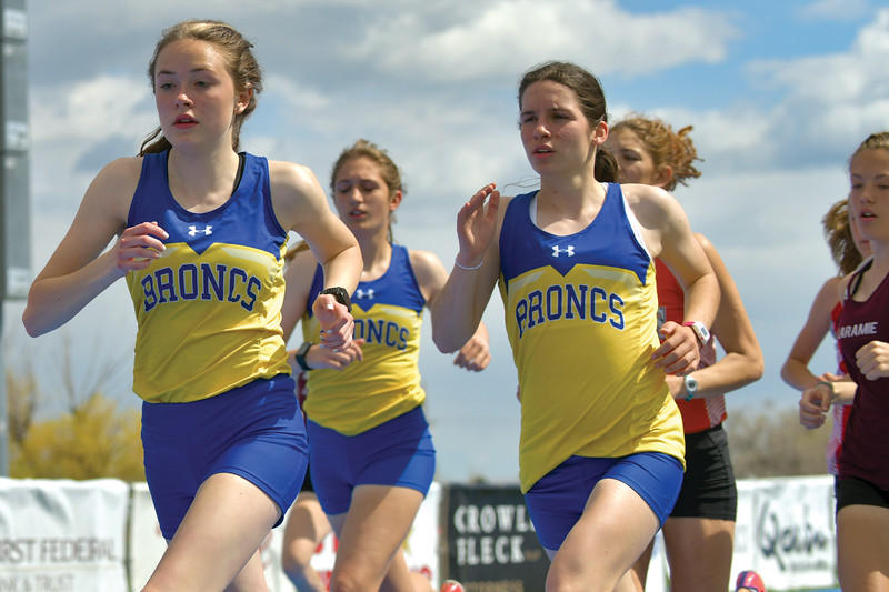 Matthew Gaston | The Sheridan Press<br>Sheridan distance runners, from left, Sylvia Brown, Sarah Gonda and Kate Moran keep it close during the first few laps of the 3200-meter run during regionals at Homer Scott Field Friday, May 10, 2019.