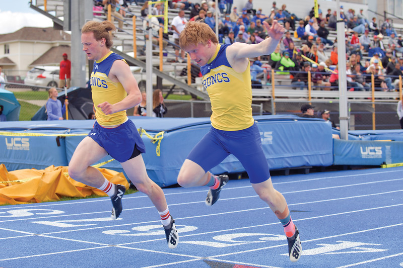 Matthew Gaston | The Sheridan Press<br>Sheridan's Alec Riegert, left, finishes just a fraction of a second before teammate Brock Bomar during the 200-meter dash preliminaries at the regional track meet Friday, May 10, 2019.