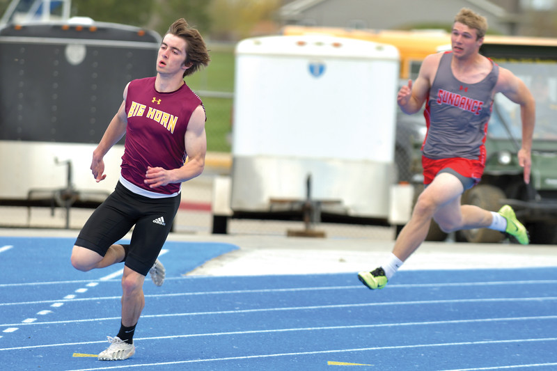 Matthew Gaston | The Sheridan Press<br>Big Horn's Carson Bates stretches his lead coming out of the turn during the 200-meter dash Friday, May 10, 2019.