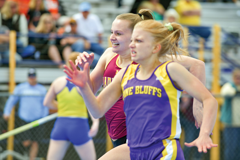 Matthew Gaston | The Sheridan Press<br>Big Horn's Sydney Schmidt comes from behind to win her heat during the girls 200-meter dash at the regional track meet Friday, May 10, 2019.