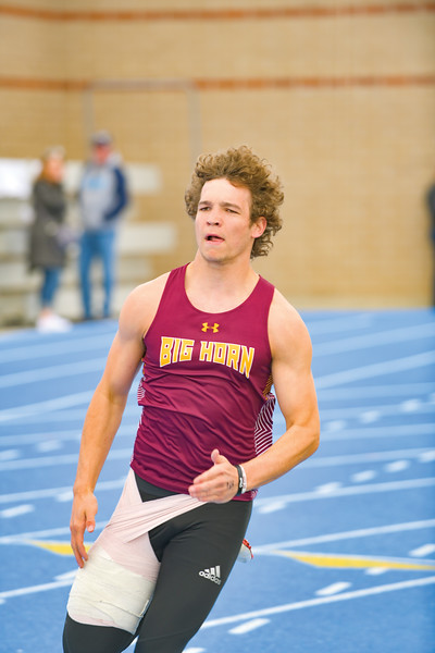Matthew Gaston | The Sheridan Press<br>Big Horn's Kade Eisele rounds the turn during the 200-meter dash at the regional track meet Friday, May 10, 2019.