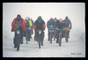 "A group of penitent souls work together in the initial miles of the ""White Hell'  Iditabike in 1992."