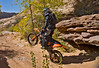 Dropping off a Sandstone Ledge while riding with Dual Sport Utah - Photo by Pat Bonish