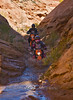Dropping into the Sink Holes in the Tubes while riding with Dual Sport Utah - Photo by Pat Bonish