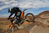 Chad going over the lip of 'Big Drop' heading down into the Desert - Riding with Dual Sport Utah - Photo by Pat Bonish