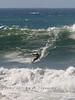Boarding down the front of a big Wave - Jamala Beach California - Photo by Pat Bonish