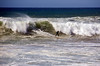 Surfing the Swells at Jamala Beach - Photo by Pat Bonish