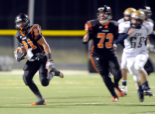 """Erie High School's Christian Mickey runs back a kick off for big yards during a football game on Friday, Oct. 5, against Frederick High School at Erie High School. For more photos of the game go to  <a href=""""http://www.dailycamera.com"""">http://www.dailycamera.com</a><br /> Jeremy Papasso/ Camera"""