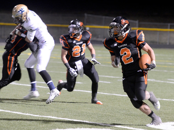 "Erie High School's Pedro Anderson runs the ball during a football game on Friday, Oct. 5, against Frederick High School at Erie High School. For more photos of the game go to  <a href=""http://www.dailycamera.com"">http://www.dailycamera.com</a><br /> Jeremy Papasso/ Camera"