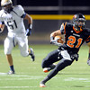 "Erie High School's Christian Mickey runs the ball during a football game on Friday, Oct. 5, against Frederick High School at Erie High School. For more photos of the game go to  <a href=""http://www.dailycamera.com"">http://www.dailycamera.com</a><br /> Jeremy Papasso/ Camera"