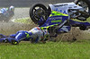 Argentine rider Sebastian Porto of the Telefonica Movistar Junior team crashes his Honda motorcycle during the 250cc category race of the Cinzano Rio Grand Prix at the Nelson Piquet racetrack in Rio de Janeiro, Brazil on Saturday Sept. 20, 2003. ((Austral Foto/Renzo Gostoli))