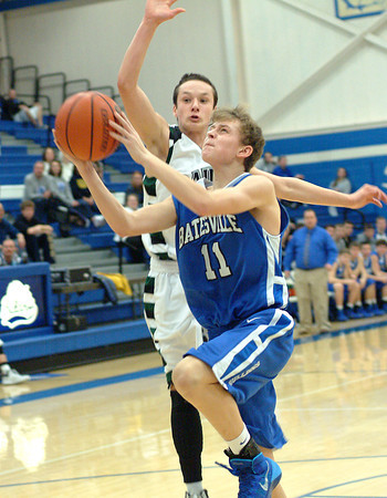 Staff photo by Bryan Helvie<br /> Getting fouled: Batesville High School freshman Garrett Burkhart gets fouled going up for a lay-up in the first half against South Ripley.
