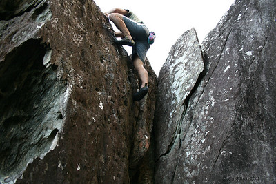 Trent bouldering at Etty Bay, Innisfail. Photo by Craig Gilbert