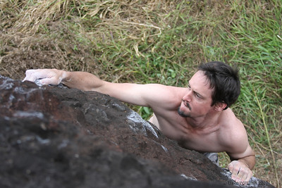 Craig bouldering at Nerada Rocks, Innisfail. He's climbing Tupperware Party (V2)