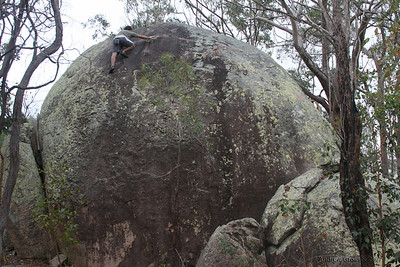 Trent climbing on Feet & Knuckles (V1), Harveys Marbles, Townsville. Photo by Andrew Grosser