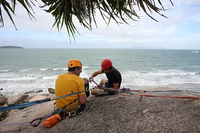 Trent demonstrating the construction of a rock climing achor. Rock climbing at Magnetic Island, Australia. Photo by Marikki.