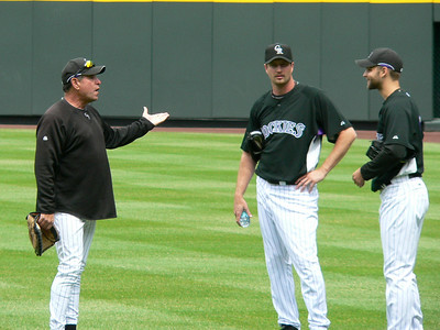 Pitching coach Bob Apodaca and Taylor Buchholz