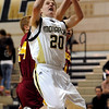 """Isaac Spence of Monarch goes up and under Ethan Karp of Rocky Mountain on Friday night. For more photos of Monarch, go to  <a href=""""http://www.dailycamera.com"""">http://www.dailycamera.com</a>.<br /> Cliff Grassmick / January 15, 2010"""