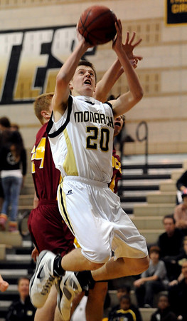 "Isaac Spence of Monarch goes up and under Ethan Karp of Rocky Mountain on Friday night. For more photos of Monarch, go to  <a href=""http://www.dailycamera.com"">http://www.dailycamera.com</a>.<br /> Cliff Grassmick / January 15, 2010"