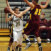 """Isaac Spence of Monarch looks to pass around the Chris Roglen of Rocky Mountain. For more photos of Monarch, go to  <a href=""""http://www.dailycamera.com"""">http://www.dailycamera.com</a>.<br /> Cliff Grassmick / January 15, 2010"""
