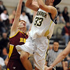 """Nathan Brooks of Monarch shoots over Michael Hoppal of Rocky Mountain on Friday.For more photos of Monarch, go to  <a href=""""http://www.dailycamera.com"""">http://www.dailycamera.com</a>.<br /> Cliff Grassmick / January 15, 2010"""