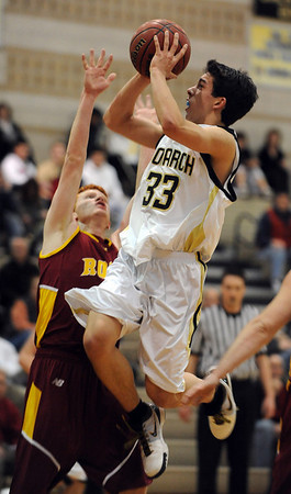 "Nathan Brooks of Monarch shoots over Michael Hoppal of Rocky Mountain on Friday.For more photos of Monarch, go to  <a href=""http://www.dailycamera.com"">http://www.dailycamera.com</a>.<br /> Cliff Grassmick / January 15, 2010"