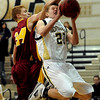 """Isaac Spence of Monarch goes up and under Ethan Karp of Rocky Mountain on Friday night.<br />  For more photos of Monarch, go to  <a href=""""http://www.dailycamera.com"""">http://www.dailycamera.com</a>.<br /> Cliff Grassmick / January 15, 2010"""