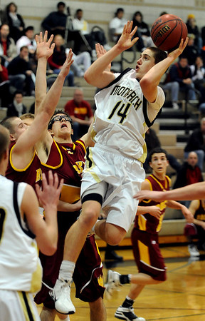 "Max Stanford of Monarch puts up a shot on several Rocky Mountain defenders. For more photos of Monarch, go to  <a href=""http://www.dailycamera.com"">http://www.dailycamera.com</a>.<br /> Cliff Grassmick / January 15, 2010"