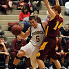 """Nate McGinley of Monarch, drives around Michael Hoppal of Rocky Mountain on Friday.<br />  For more photos of Monarch, go to  <a href=""""http://www.dailycamera.com"""">http://www.dailycamera.com</a>.<br /> Cliff Grassmick / January 15, 2010"""