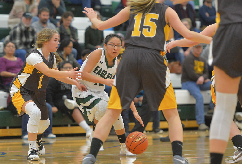 Justin Sheely | The Sheridan Press<br /> Tongue River's Raeshawna Red Star drives the ball against Rocky Mountain at Tongue River High School Friday, December 8, 2017. The Lady Eagles lost 43-28.