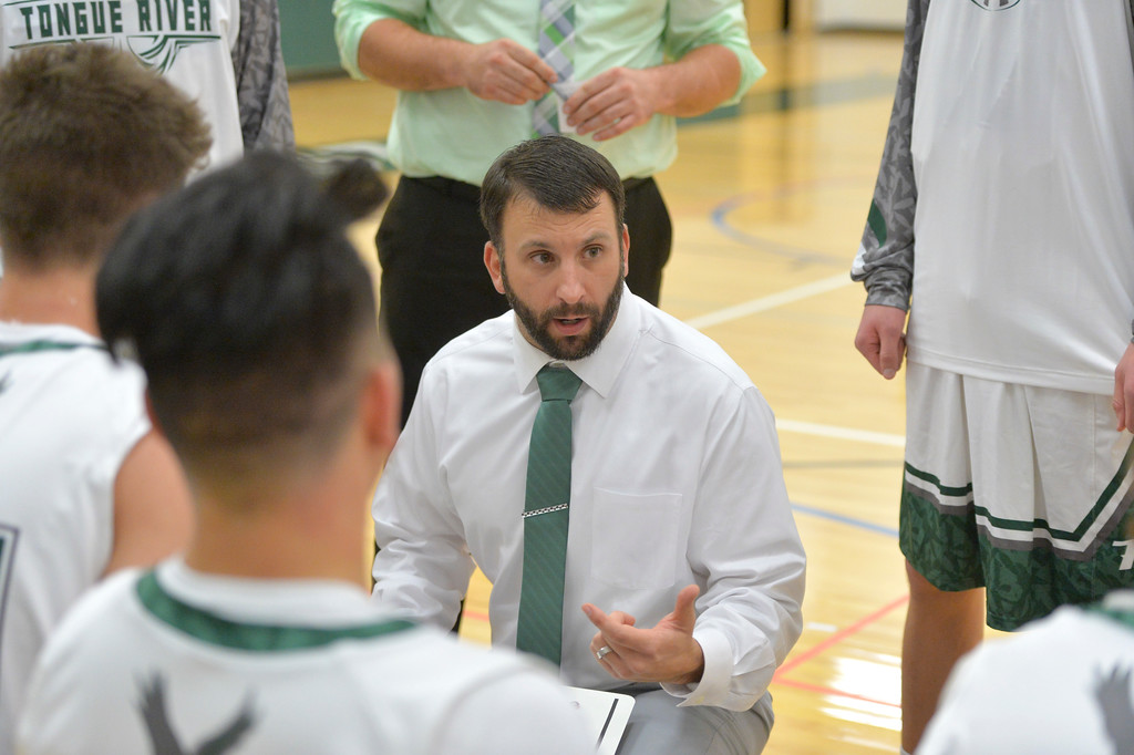 Justin Sheely | The Sheridan Press<br /> Tongue River boys basketball head coach Ronnie Stewart calls a timeout against Rocky Mountain at Tongue River High School Friday, December 8, 2017. The Eagles lost to Rocky Mountain 85-40.