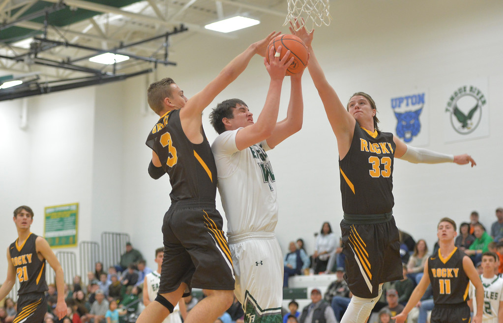 Justin Sheely | The Sheridan Press<br /> Tongue River's Hugh Patterson is guarded by Rocky Mountain's Ethan Price (3) and Colby Davison at Tongue River High School Friday, December 8, 2017. The Eagles lost to Rocky Mountain 85-40.