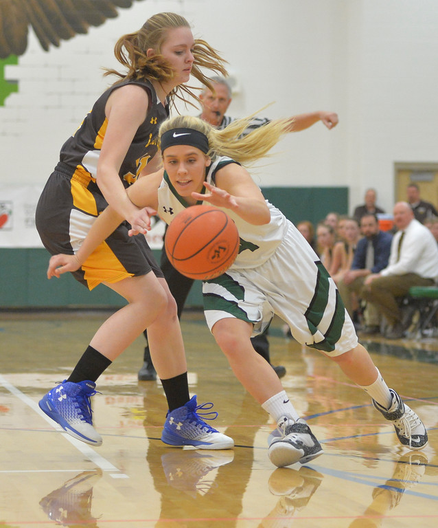Justin Sheely | The Sheridan Press<br /> Tongue River's Brittany Fillingham drives the ball against Rocky Mountain's Jade Minchow at Tongue River High School Friday, December 8, 2017. The Lady Eagles lost 43-28.