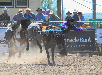 Day one of the Panhandle High School Rodeo, at Scotts Bluff County Fairgrounds in Mitchell, NE. In the Saddle Bronc ride Gering's Riley Haug Gets bucked from the Bronc.