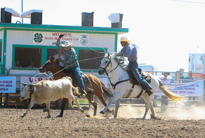 Day one of the Panhandle High School Rodeo, at Scotts Bluff County Fairgrounds in Mitchell, NE. In the Team Roping Will Frerichs of Bayard in Green and Terrel Vineyard of Oshkosh