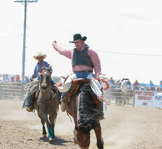 Day one of the Panhandle High School Rodeo, at Scotts Bluff County Fairgrounds in Mitchell, NE. In the Saddle Bronc ride Kimball High School's Nicholas Stull ride for a score of 56 points, putting him in third for the weekend event. In back: Wayne Larsen keeps pace as the pick-up man for the riders.