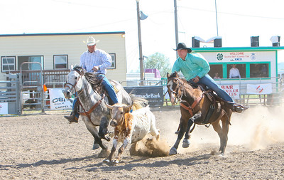 Day one of the Panhandle High School Rodeo, at Scotts Bluff County Fairgrounds in Mitchell, NE. In the Steer Wrestling Scottsbluff's Zach Phillips.