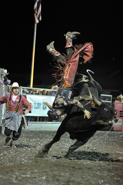 Walt Hester | Trail Gazette<br /> Dillon Tyner looks to splash down after launch from his bull on Sunday. Tyner was the last cowboy dismounted in this year's Rooftop Rodeo.