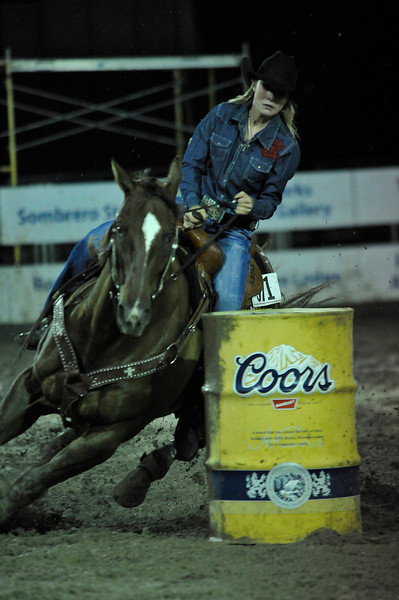 Walt Hester | Trail Gazette<br /> A racer rounds the last barrel during the Rooftop Rodeo barrel racing competition. Racers make a cloverleaf pattern around three barrels, trying to get as close as possible without knocking them over.