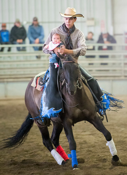 Fort Macleod, Alta _ Sept. 15, 2018 _ Baby On Board _ Joel Lybbert of Valleyview, Alta. spins his horse Calling Hollywood with two_month_old baby Tylie aboard. Horse trainers from throughout Alberta and one from BC gathered at Fort Macleod for the Rocking Horse Ranch Colt Starting Challenge Sept. 15 at the Midnight Stadium. Competitors perform a routine of 11 compulsory tasks in front of judges. Trainers are also given a three_minutes in a Wow Factor competition to demonstrate other freestyle horsemanship. They are able to use props for this competition.  (Mike Sturk photo)