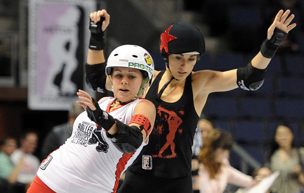 "Annie Maul, front, of Kansas City, tries to keep Smarty Pants of Texas, from making progress.<br /> The WFTDA Roller Derby Championships were held this weekend at the 1st Bank Center in Broomfield<br /> For more photos of the Roller Derby, go to  <a href=""http://www.dailycamera.com"">http://www.dailycamera.com</a><br /> Cliff Grassmick / November 12, 2011"