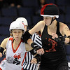 "Kelley Young, left, of Kansas City, gets an elbow from Luce Bandit of Texas.<br /> The WFTDA Roller Derby Championships were held this weekend at the 1st Bank Center in Broomfield<br /> For more photos of the Roller Derby, go to  <a href=""http://www.dailycamera.com"">http://www.dailycamera.com</a><br /> Cliff Grassmick / November 12, 2011"