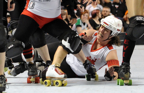 "One of the Kansas City Roller Warriors hits the deck in the Texas Rollergirls match.<br /> The WFTDA Roller Derby Championships were held this weekend at the 1st Bank Center in Broomfield<br /> For more photos of the Roller Derby, go to  <a href=""http://www.dailycamera.com"">http://www.dailycamera.com</a><br /> Cliff Grassmick / November 12, 2011"