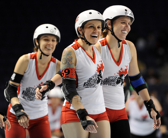 "Track Rat, center, shares a laugh with her Kansas City teammates before the match.<br /> The WFTDA Roller Derby Championships were held this weekend at the 1st Bank Center in Broomfield<br /> For more photos of the Roller Derby, go to  <a href=""http://www.dailycamera.com"">http://www.dailycamera.com</a><br /> Cliff Grassmick / November 12, 2011"