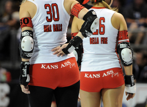 "Hall Balls, left, and Bella Fire, both of Kansas City, show off one of their assets before the match.<br /> The WFTDA Roller Derby Championships were held this weekend at the 1st Bank Center in Broomfield<br /> For more photos of the Roller Derby, go to  <a href=""http://www.dailycamera.com"">http://www.dailycamera.com</a><br /> Cliff Grassmick / November 12, 2011"