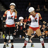 "Hall Balls, left, and Bella Fire, both of Kansas City, get loosened up before the match.<br /> The WFTDA Roller Derby Championships were held this weekend at the 1st Bank Center in Broomfield<br /> For more photos of the Roller Derby, go to  <a href=""http://www.dailycamera.com"">http://www.dailycamera.com</a><br /> Cliff Grassmick / November 12, 2011"