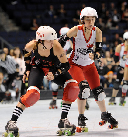 "Barbara Ambush (1600) of Texas, prepares to put a shoulder into Kelley Young of Kansas City.<br /> The WFTDA Roller Derby Championships were held this weekend at the 1st Bank Center in Broomfield<br /> For more photos of the Roller Derby, go to  <a href=""http://www.dailycamera.com"">http://www.dailycamera.com</a><br /> Cliff Grassmick / November 12, 2011"