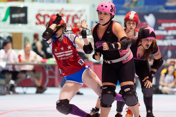 Yankee Scandal of the DC Rollergirls All Stars is sent flying by one of the Tampa Bay Derby Darlins at ECDX 2011