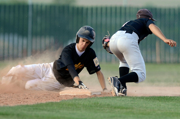 "Crystal Landscape Supplies's Jesse Shaw is tagged out by Legion Post 70's during a baseball game against on Wednesday, June 13, at Roosevelt High School in Johnstown. For more photos of the game go to  <a href=""http://www.dailycamera.com"">http://www.dailycamera.com</a><br /> Jeremy Papasso/ Boulder Daily Camera"