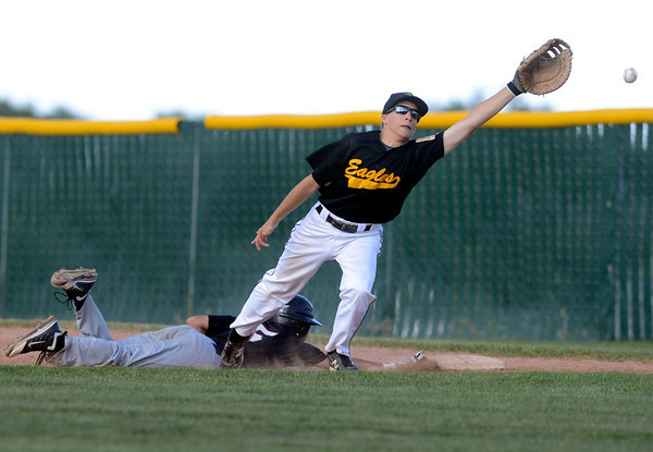 "Legion Post 70's Jason Ramirez slides in safely to first under the tag of Crystal Landscape Supplies Sam Hardy during a baseball game against on Wednesday, June 13, at Roosevelt High School in Johnstown. For more photos of the game go to  <a href=""http://www.dailycamera.com"">http://www.dailycamera.com</a><br /> Jeremy Papasso/ Boulder Daily Camera"